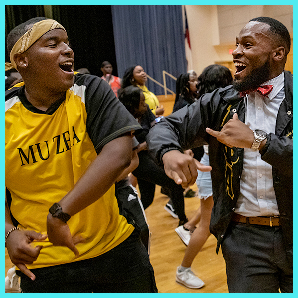 Fraternity members dance after a step show.
