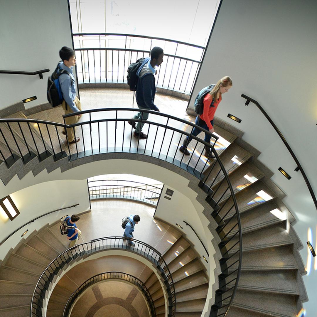 students descend a spiral staircase at Carolina's Kenan-Flagler business school