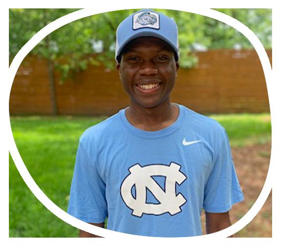 Student wearing Carolina hat and T-shirt